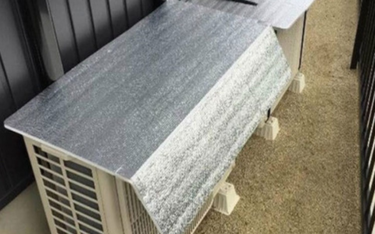 Che phủ dàn nóng bằng tấm bạc cách nhiệt